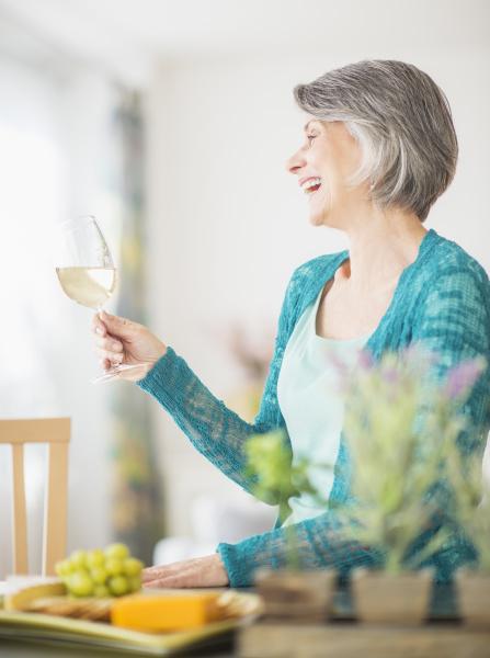 portrait of woman raising wine glass