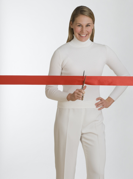 woman cutting red tape