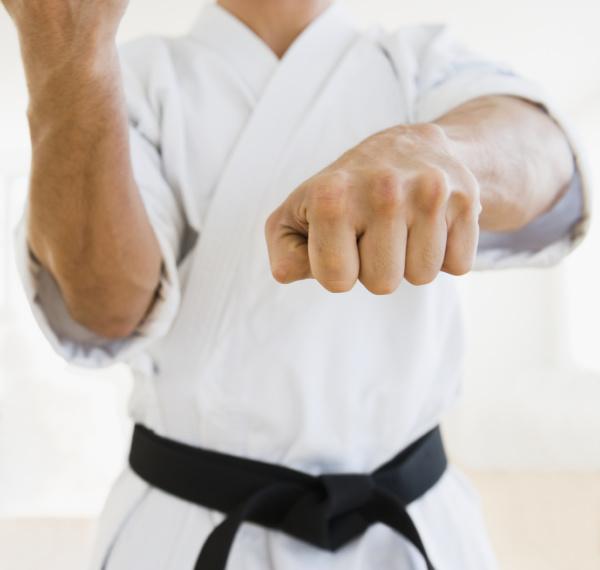 male karate black belt in fighting
