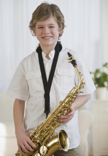 boy holding saxophone