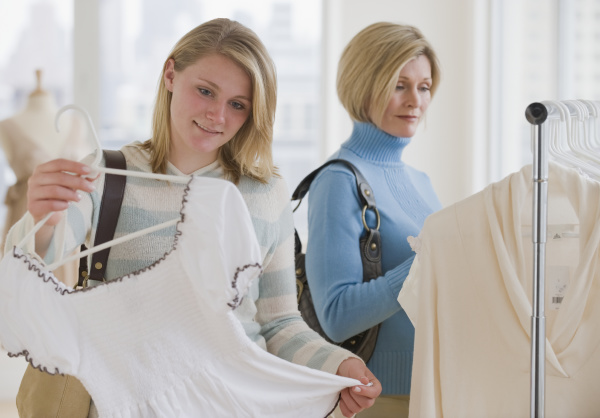 mother and daughter clothes shopping