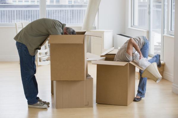 couple unpacking moving boxes
