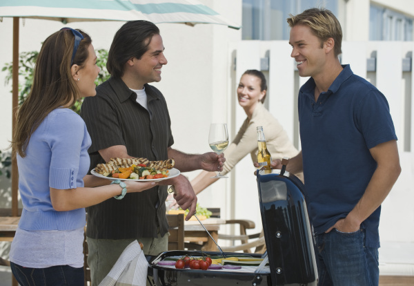couples barbecuing on patio