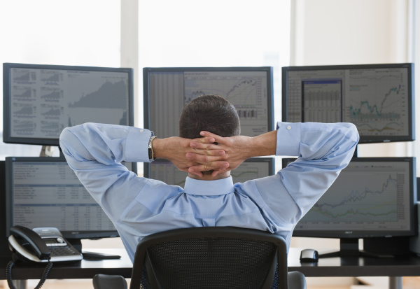 relaxed male trader at work