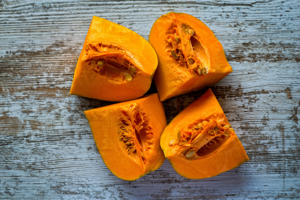 ripe pumpkin pieces on the gray