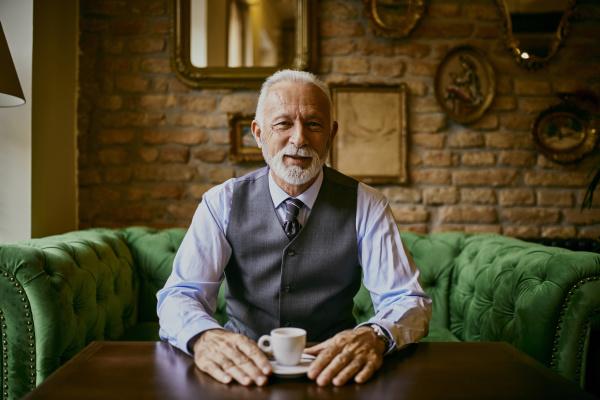 portrait of elegant senior man sitting