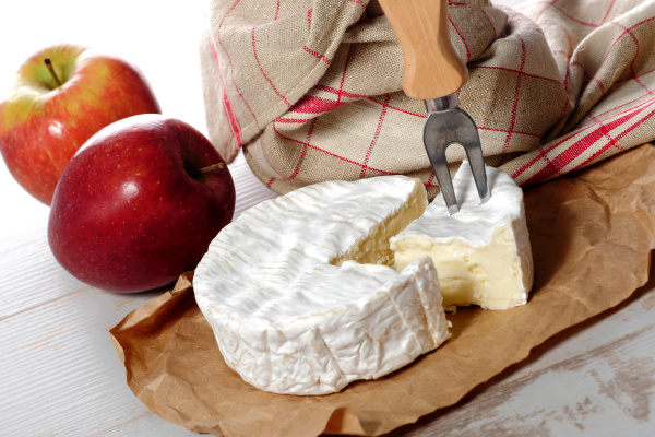 camembert of normandie with red apple