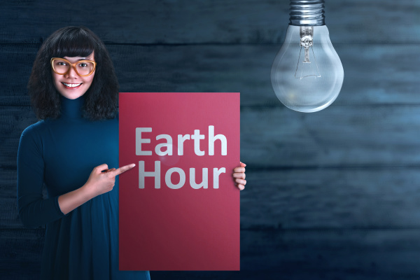 young asian woman showing earth hour