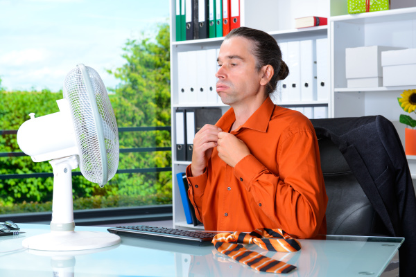 young business man with ventilator at