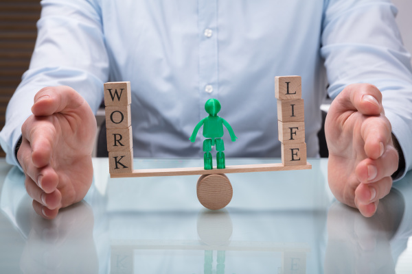 businessperson protecting balance between life and
