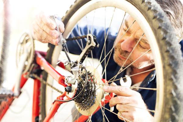 man reparing bicycle