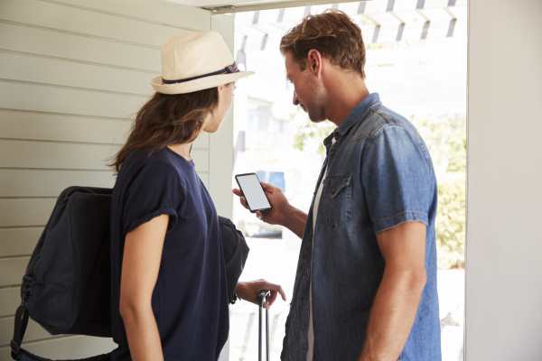 couple using online app to book