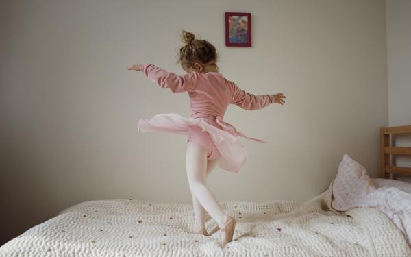 girl in ballet costume dancing on