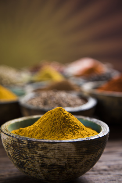 spices and herbs and wooden bowl