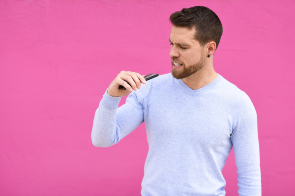 young man recording a voice note