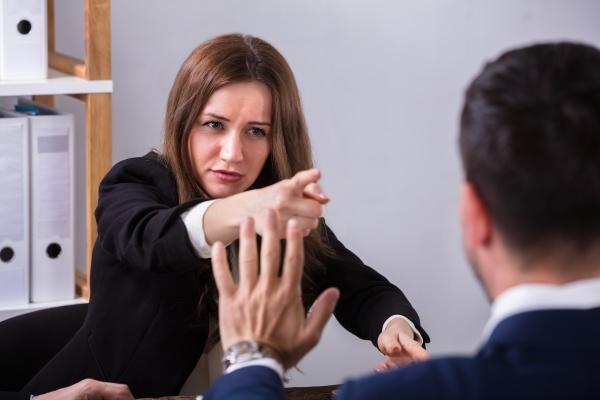 businesswoman scolding her colleague