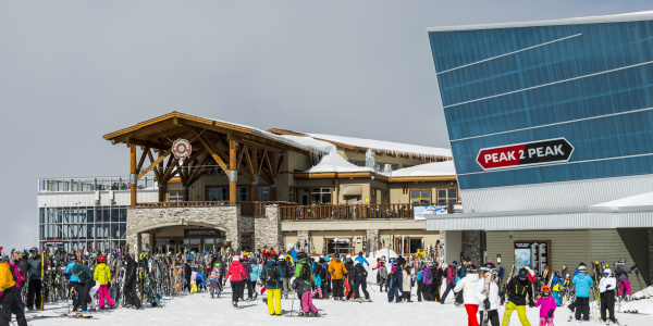 downhill skiiers gather at the lodge