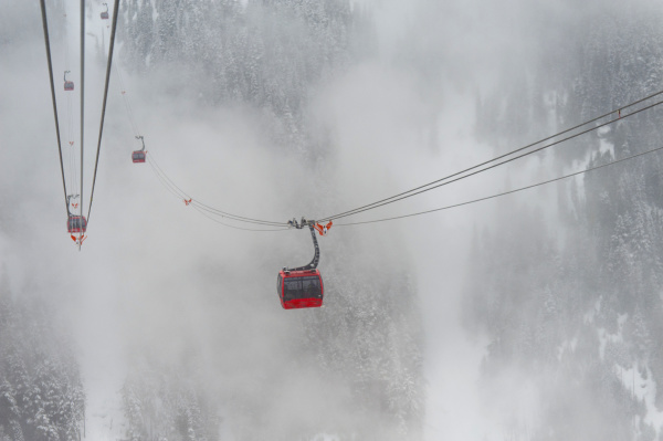 a red cable car above the
