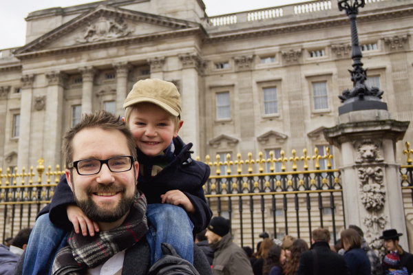 father and son outside buckingham palace