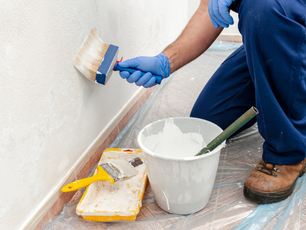 house painter at work painting a