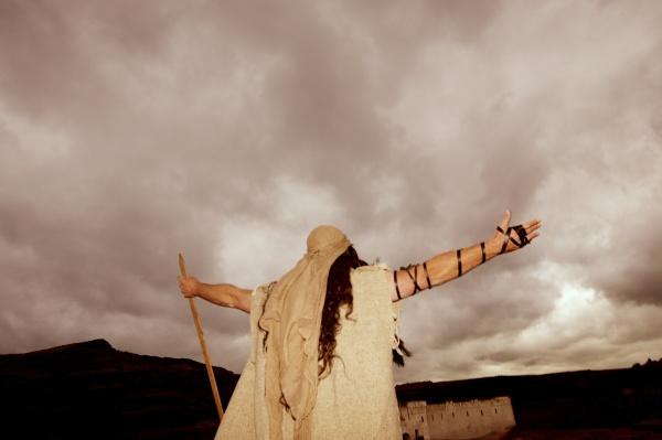 arms raised towards heaven
