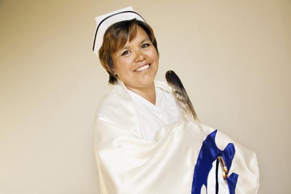 nurse wearing a ceremonial shawl