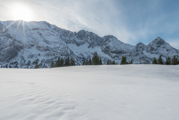 austrian alps with snow and sunshine