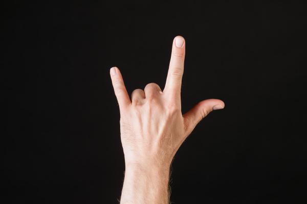 male hand showing rock n