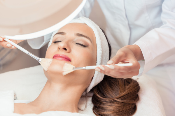 beautiful woman during anti aging facial