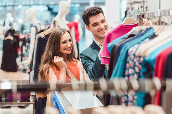 couple shopping for fashion items in