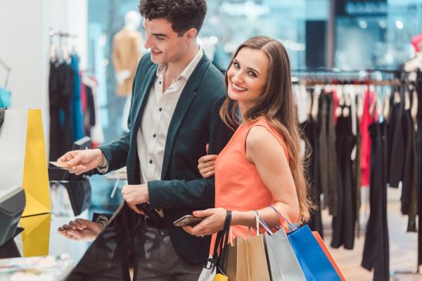 man buying his woman fashion items