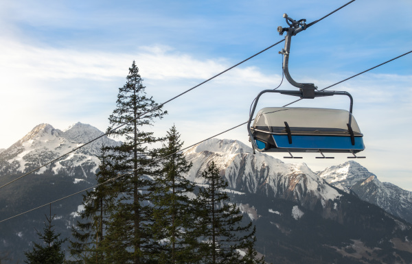 ski chairlift and alps mountains