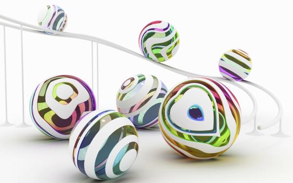 multi colored balls rolling down ramp