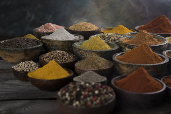 assortment of spices in wooden bowl
