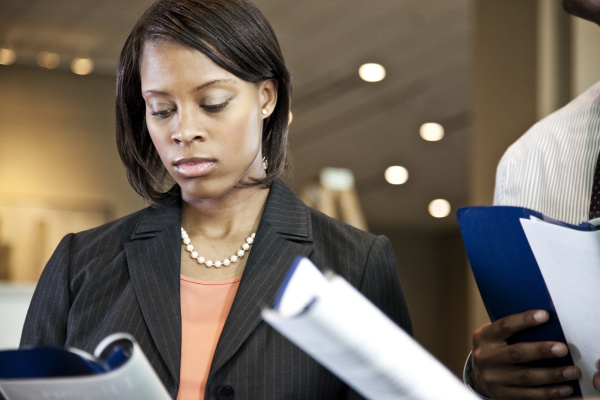 a black businesswoman reading a report