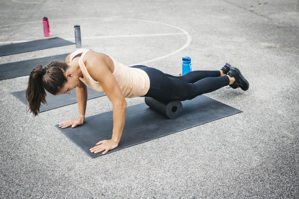 young woman doing workout exercise with