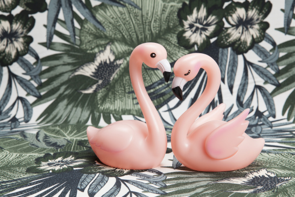couple of pink plastic flamingos on