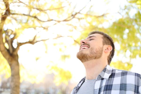 happy man is breathing fresh air