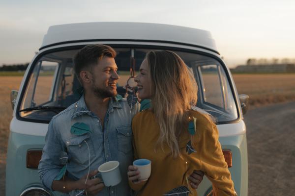 happy young couple at camper van