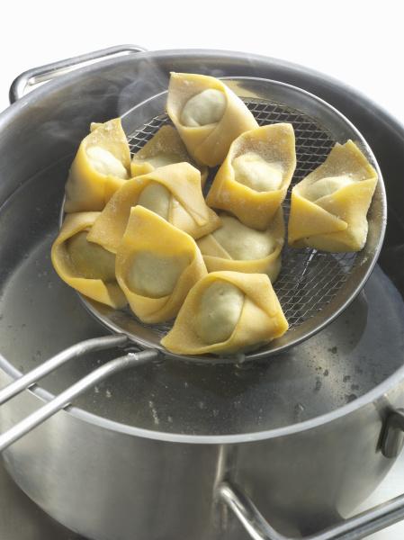 fresh tortellini in a sieve with