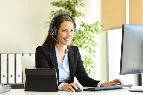happy tele marketer working looking at