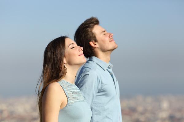 relaxed couple breathing fresh air with