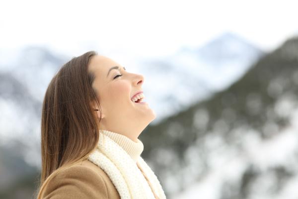 female breathing in the mountain in