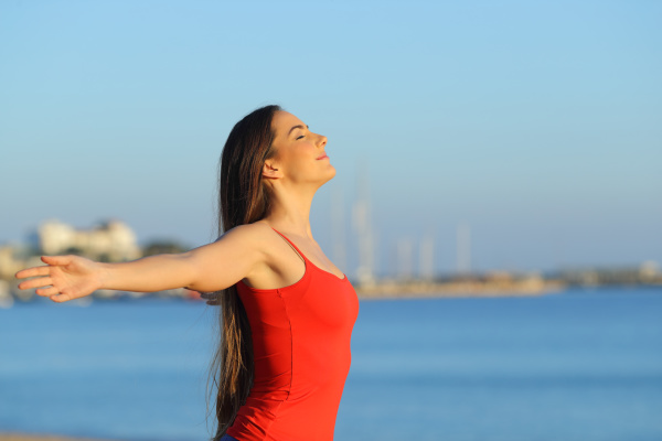relaxed girl stretching arms breathing on