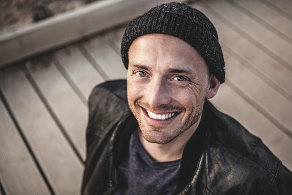 portrait of smiling man with stubble