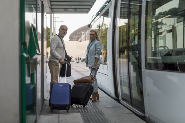 spain barcelona senior couple with baggage