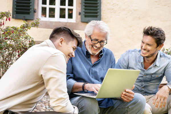 three happy men of different age