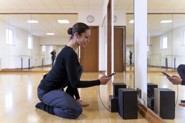 ballet dancer using cell phone in