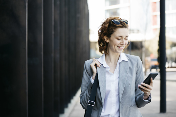 businesswoman with smartphone commuting in the