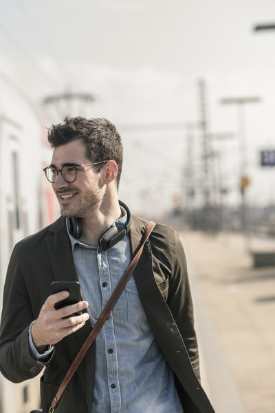 smiling young man with cell phone
